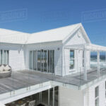 White Beach House With Balcony With Ocean View Under Sunny