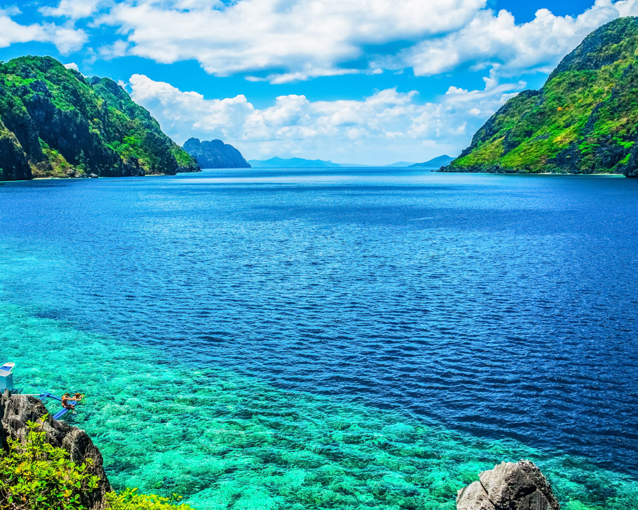 Palawan Philippines A Scenic View Of The Sea And Mountain