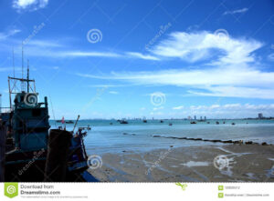 Sea View And Small Boat At The Fishing Pier Stock Photo
